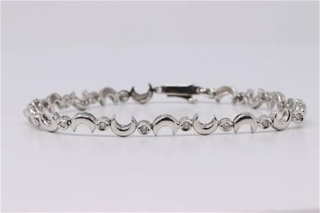 14kt White Gold Diamond Moon Bracelet.