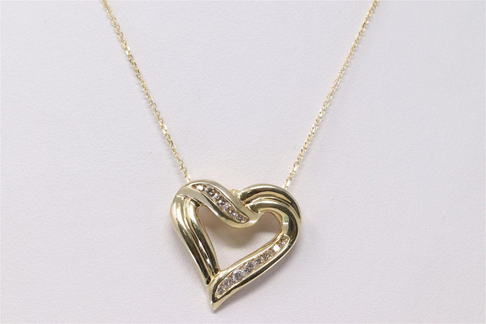 14Kt Yellow Gold Diamond Heart Pendant.