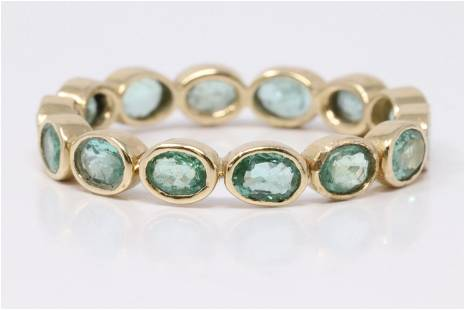 14Kt Yellow Gold Emerald Eternity Ring.