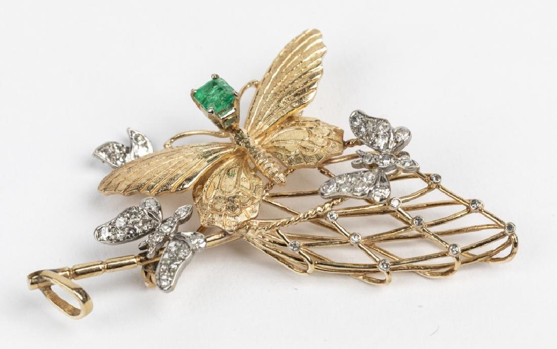 A diamond, emerald, 14k yellow gold butterfly pin
