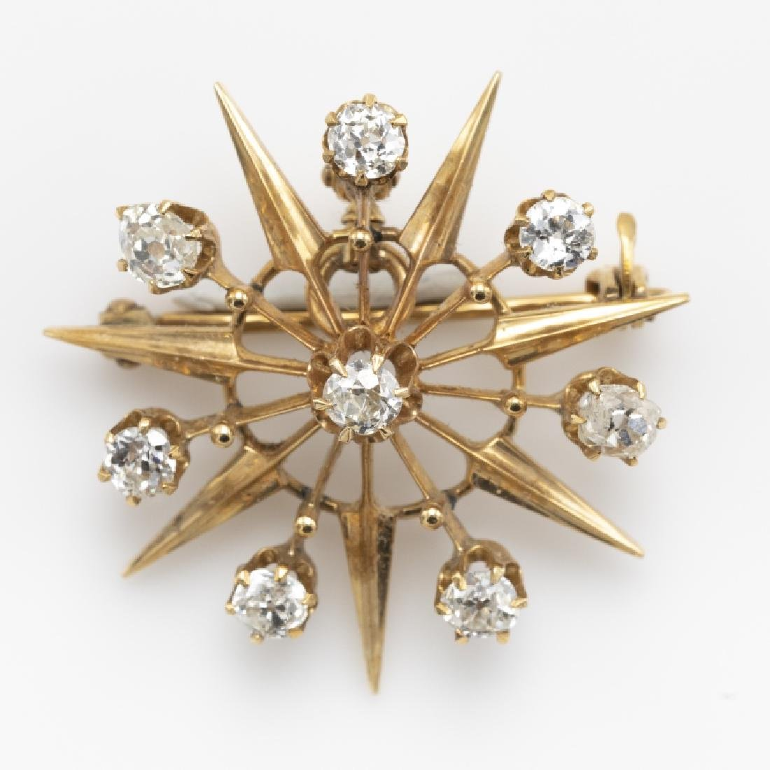 A Victorian diamond, 14k starburst pin pendant