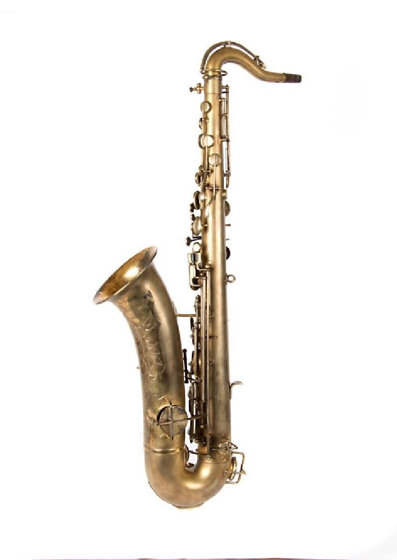 A Buescher Elkhart saxaphone in case