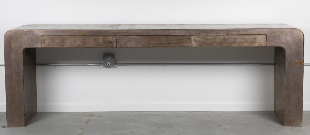 A Contemporary waterfall console table