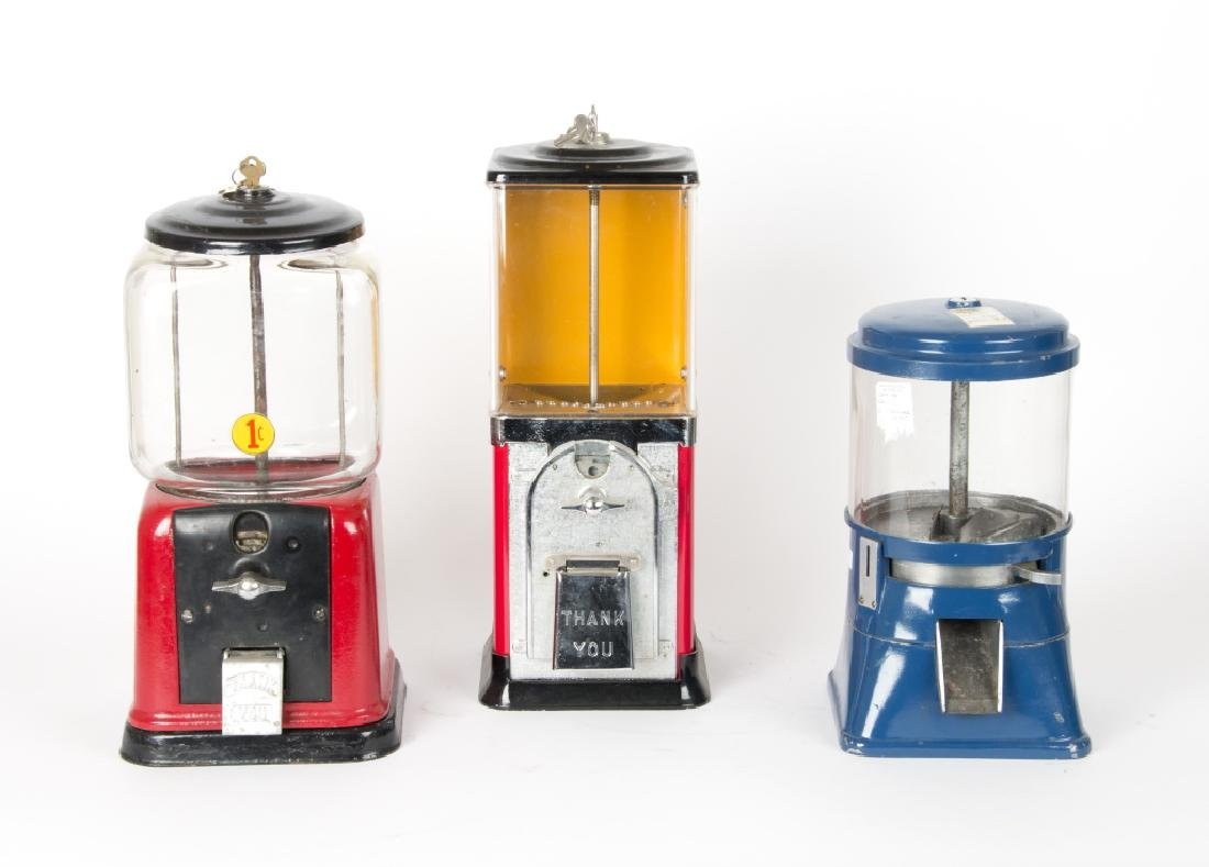 Three vintage counter top gumball machines