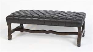A Baroque style tufted leather bench