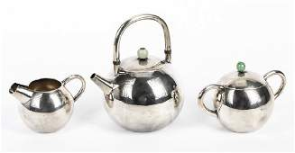 An Arthur  Bond Yokohama silver tea set