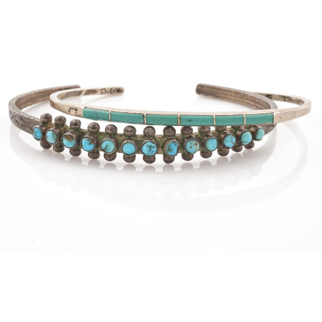 A collection of two Native American turquoise, silver