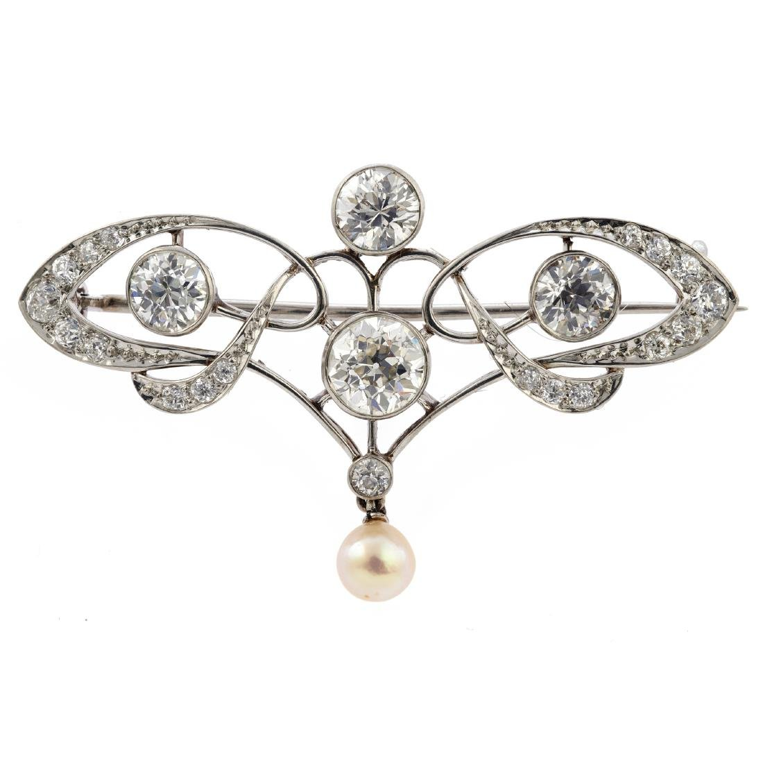 An Edwardian diamond, cultured pearl, platinum brooch