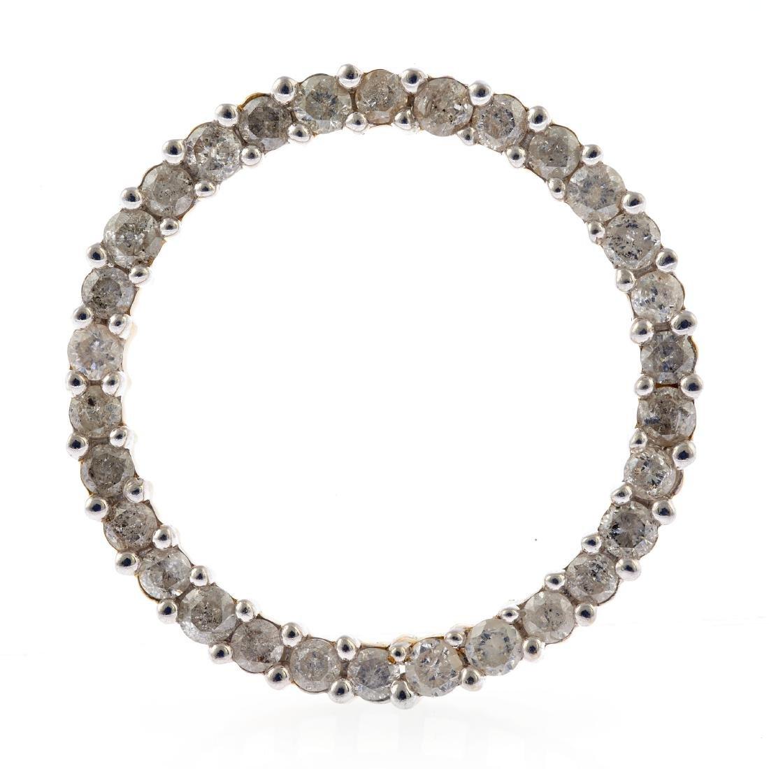 A diamond, 14k circle pendant