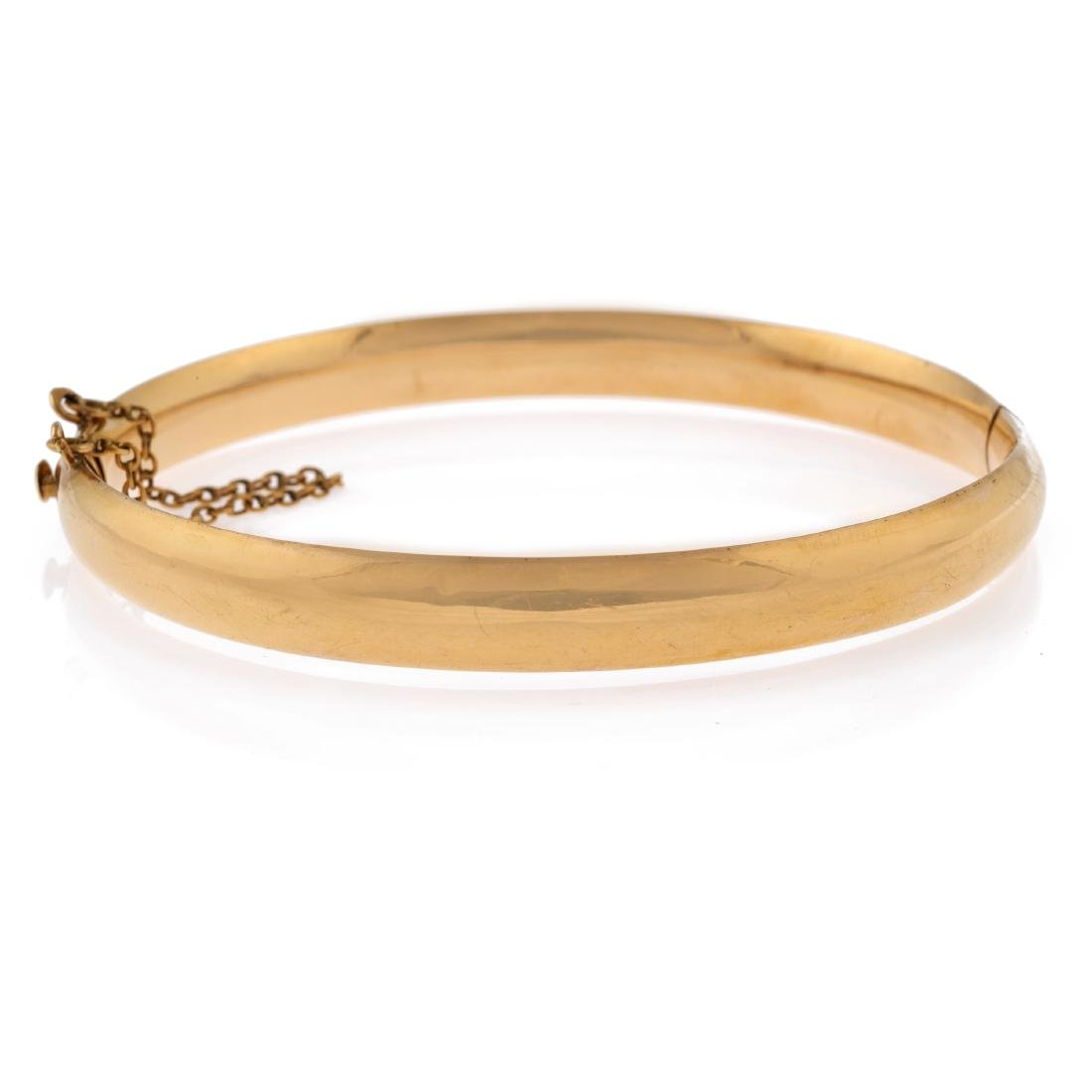 A 14k yellow gold bangle bracelet