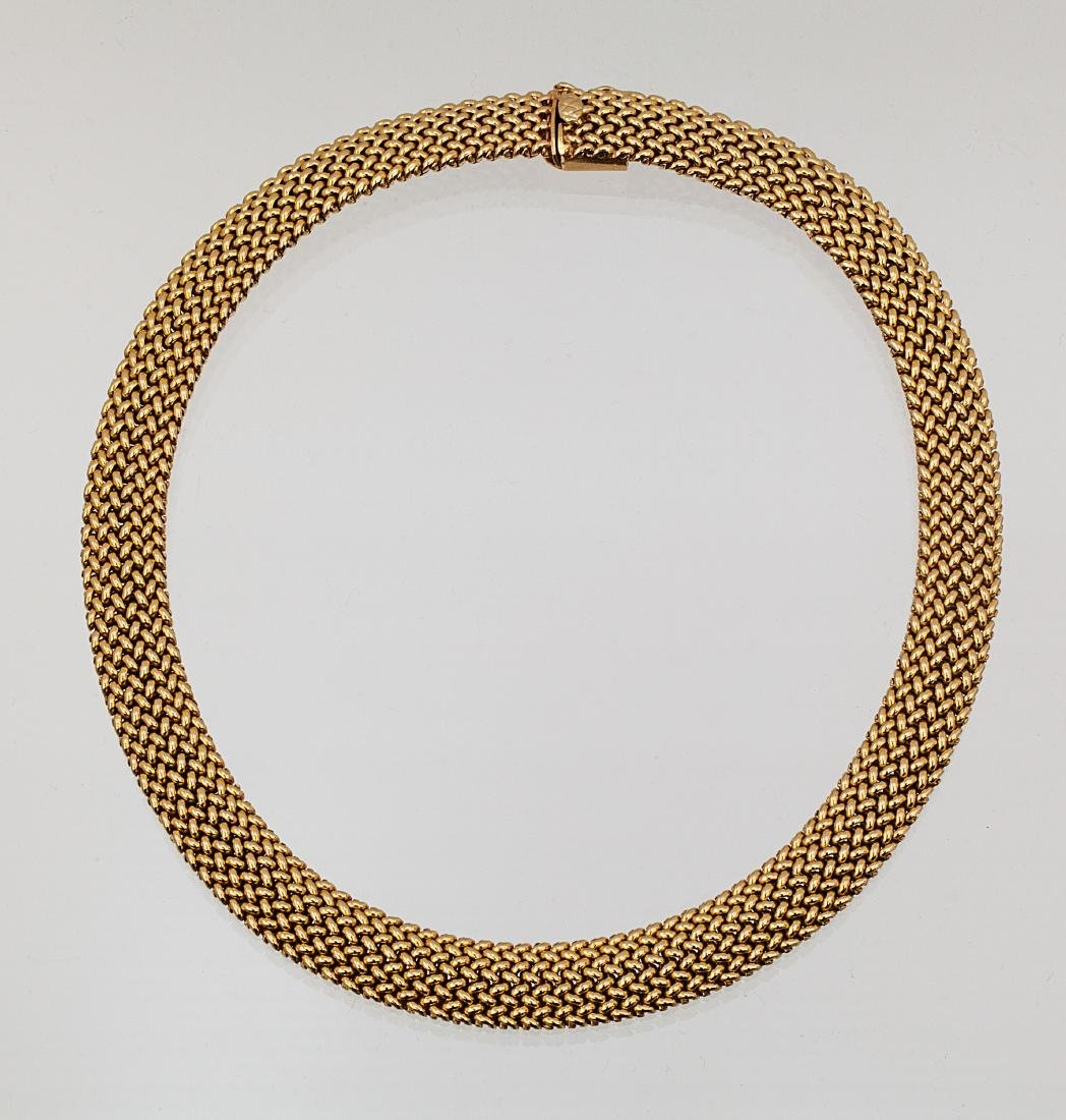 A 14k yellow gold mesh link collar necklace