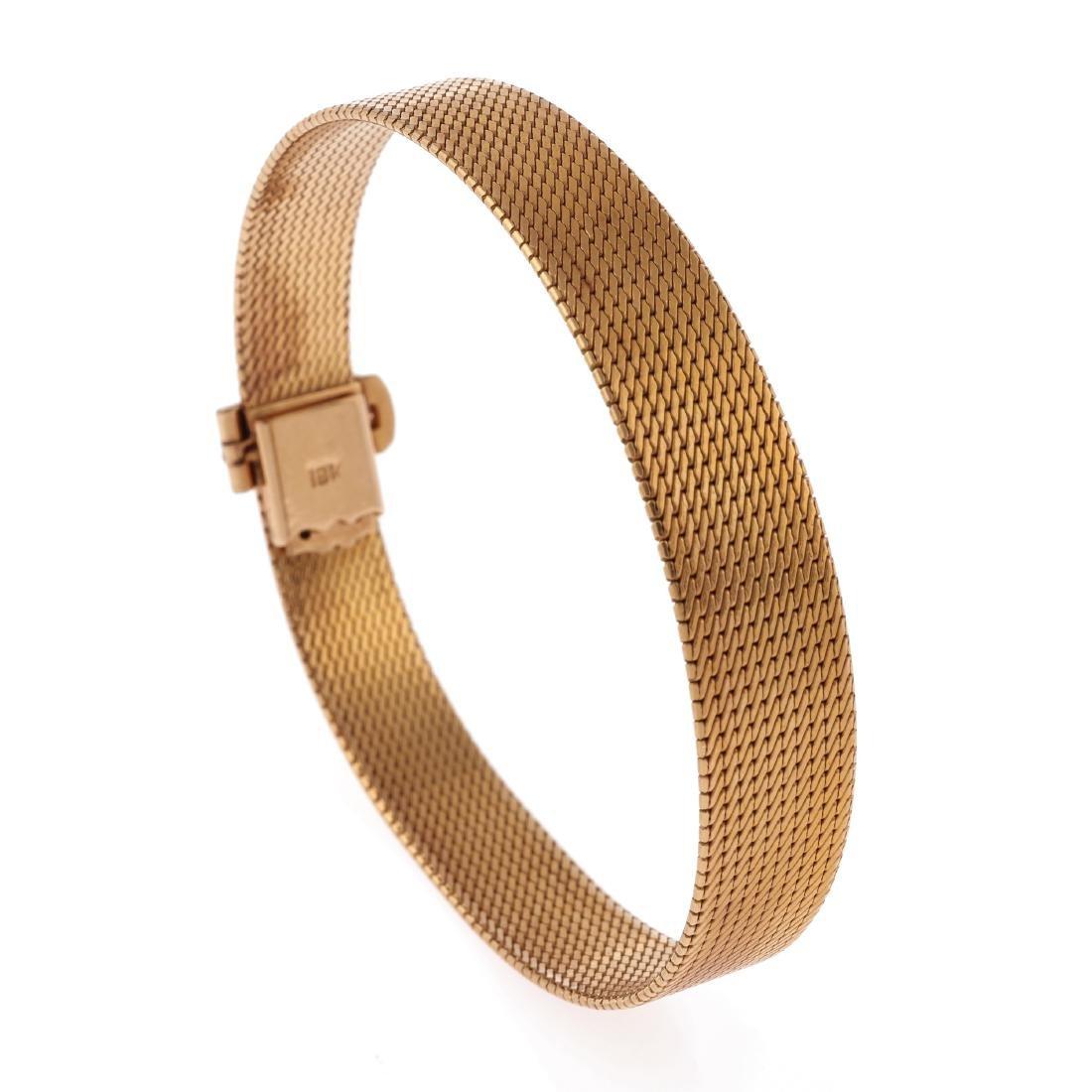An 18k yellow gold mesh bracelet