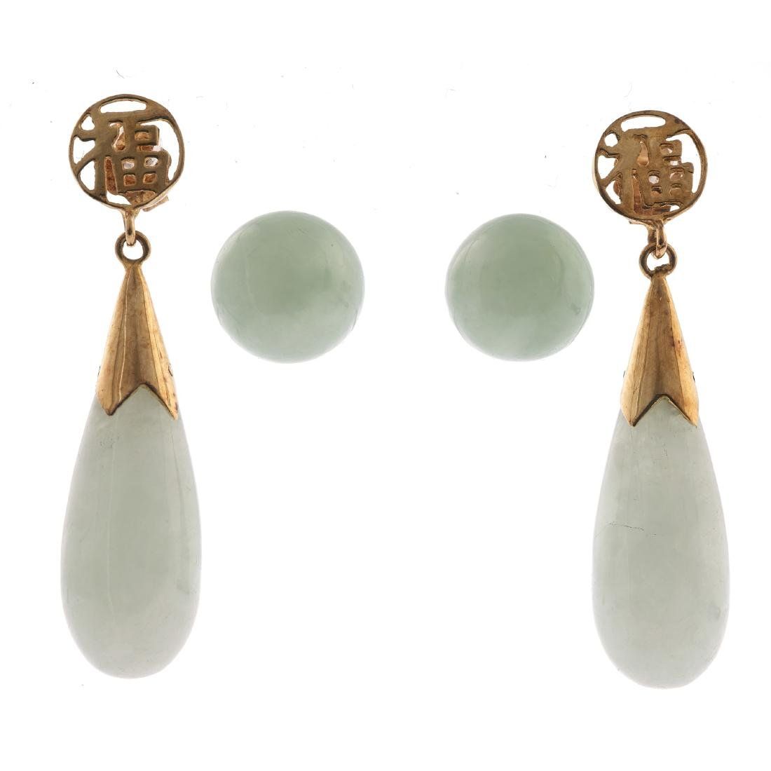 A collection of two pairs of jade, 14k earrings
