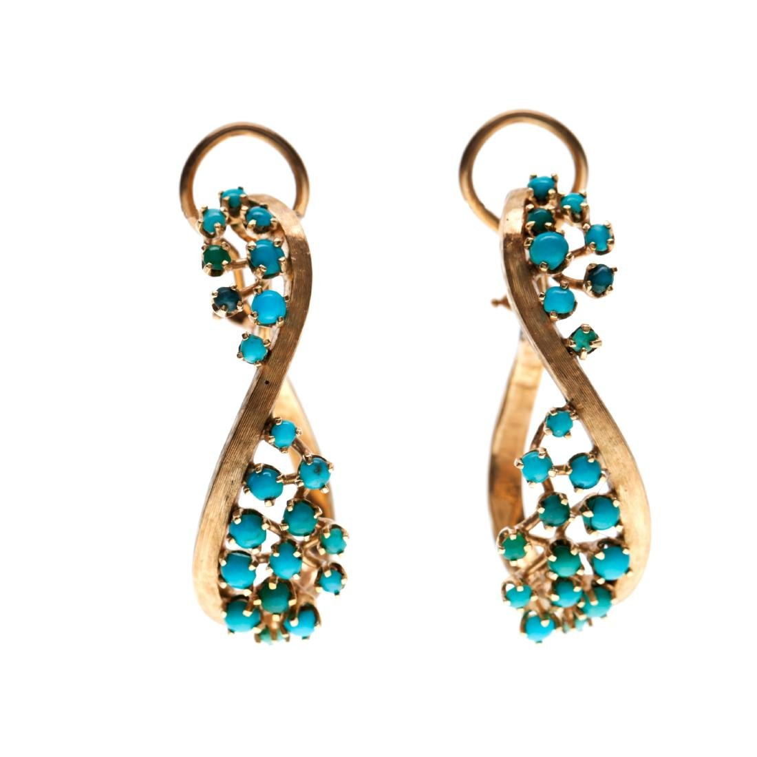 A pair of turquoise, 14k yellow gold earrings