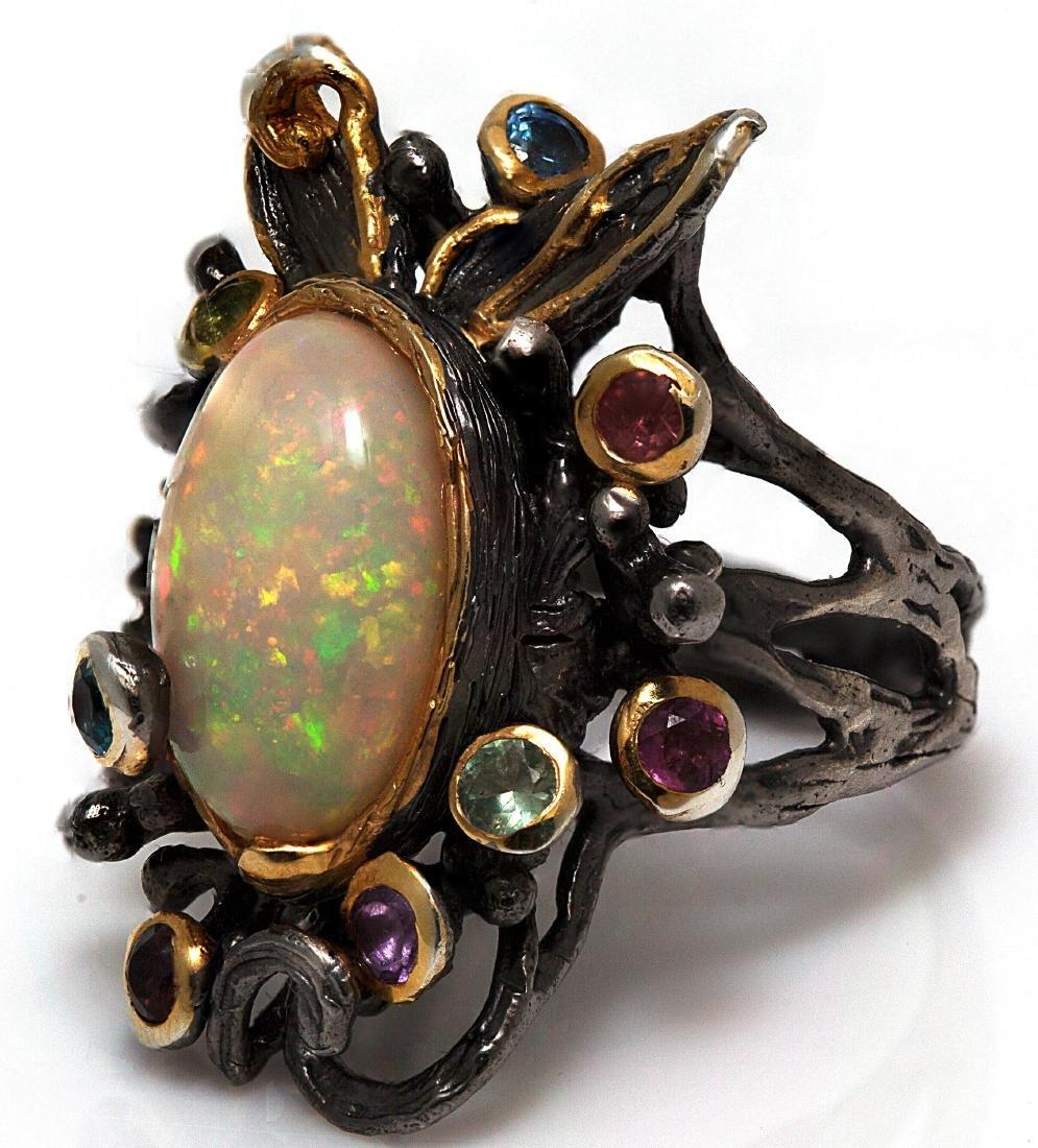 An opal, multi-stone, blackened silver ring