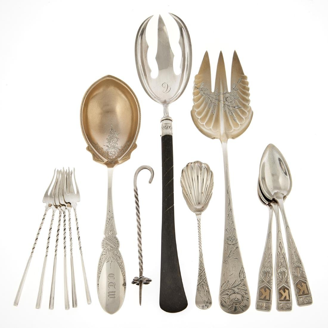 A group of sterling flatware with engraved decoration