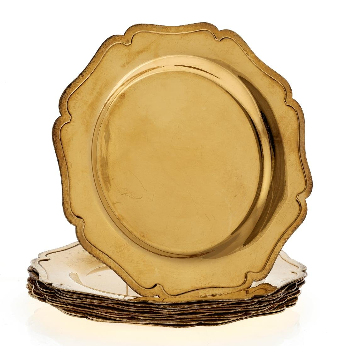 A vermeil set of twelve bread & butter plates by Shreve