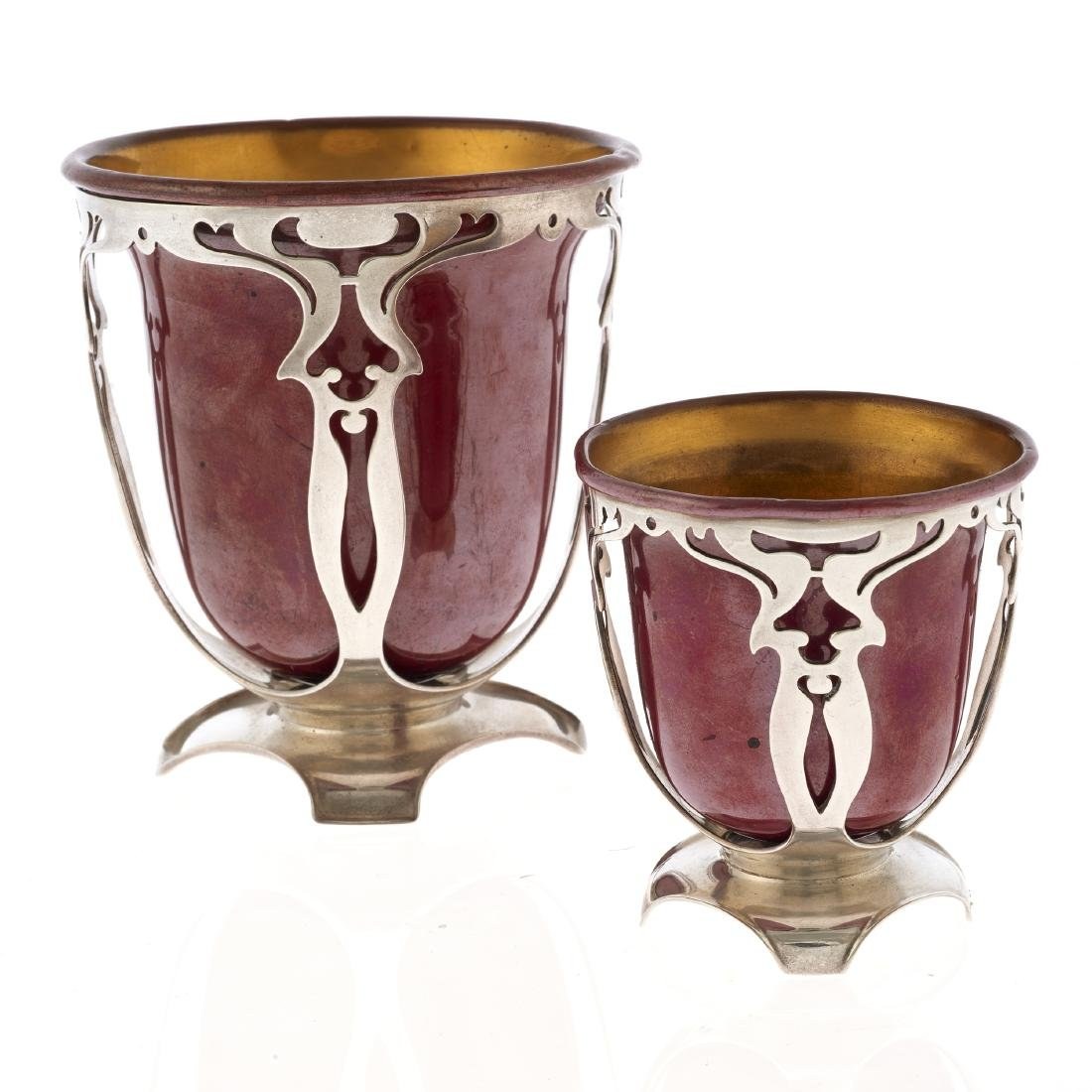 A Gorham mixed metal set of two graduated cups