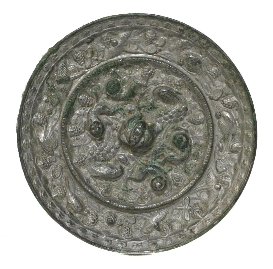 A Chinese bronze 'beasts and grapes' mirror