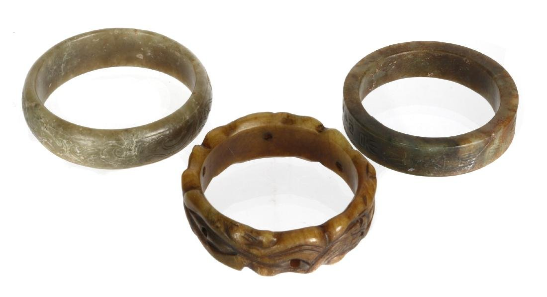 Three Chinese jade and hardstone bangles