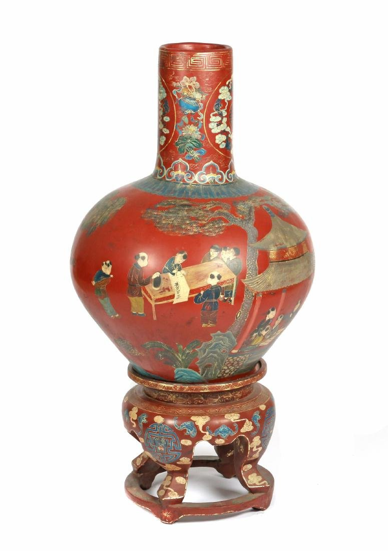 A large Chinese lacquer painted vase and stand