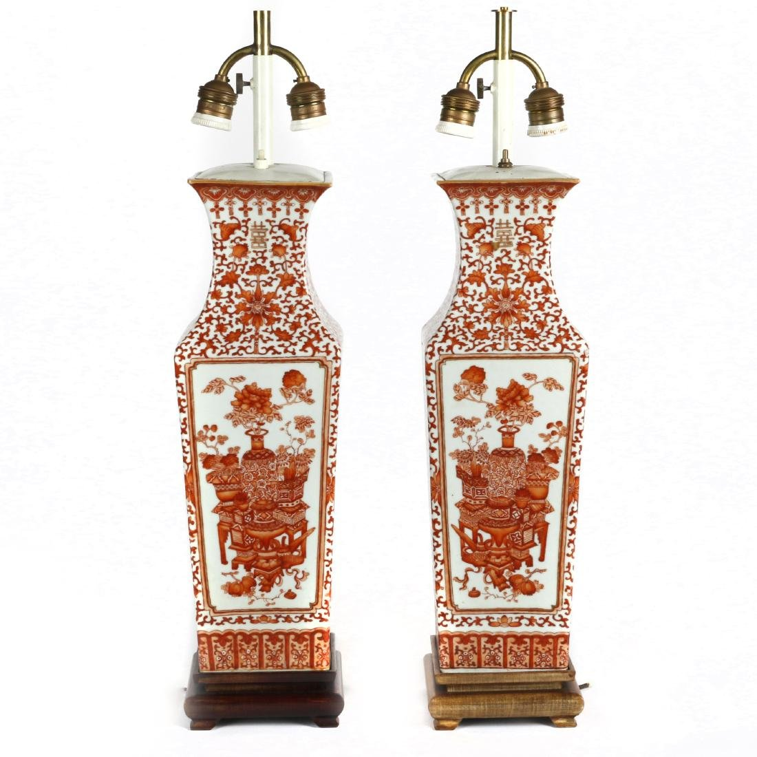 A pair of iron-red painted square form vases