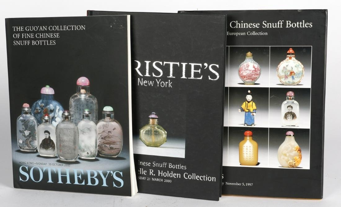 A collection of auction catalogs on snuff bottles