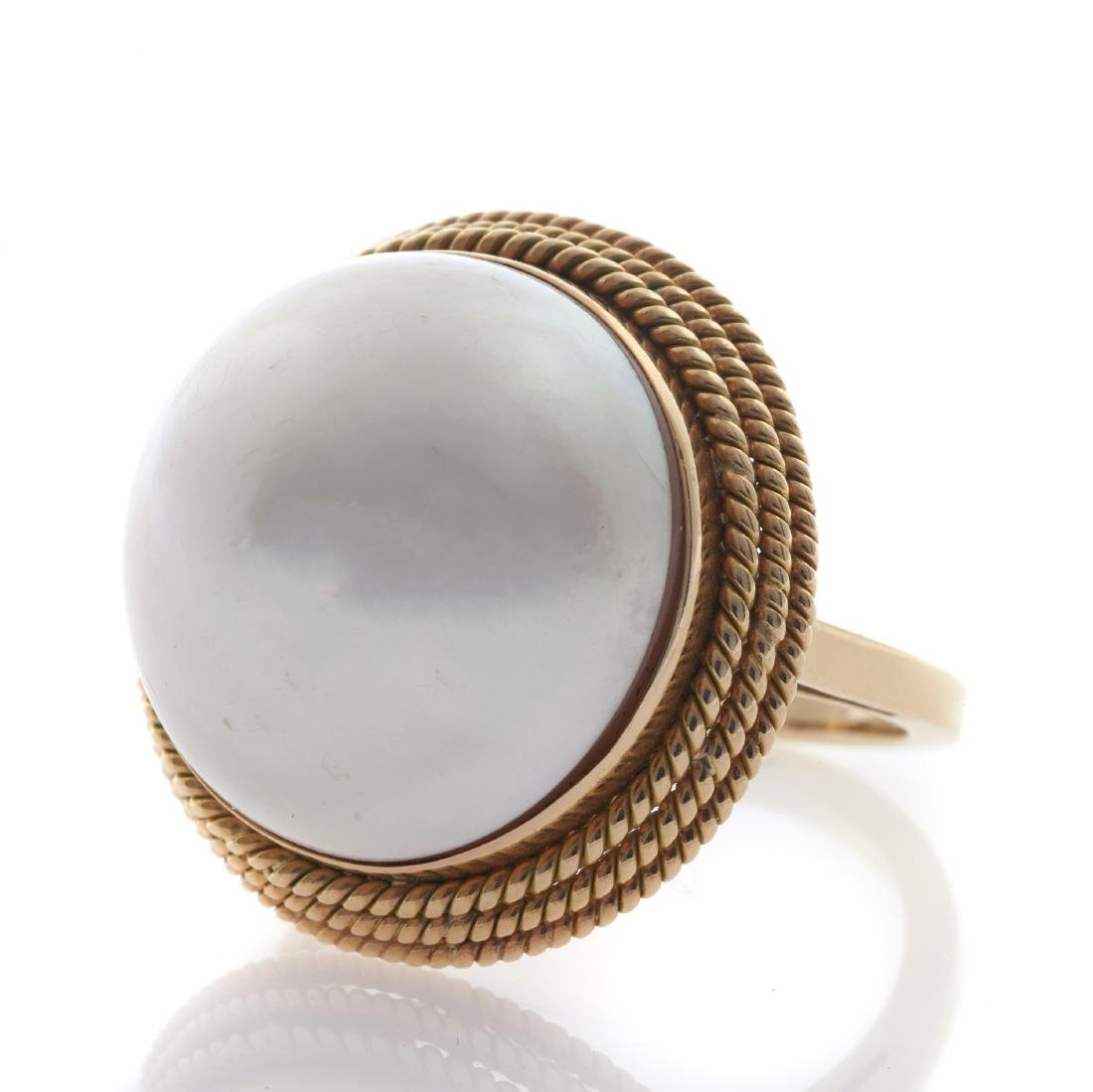 A mabe cultured pearl, 14k yellow gold ring