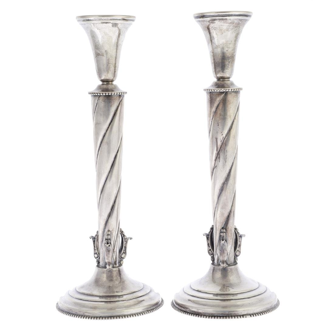 A pair of American Jensen style sterling silver candle