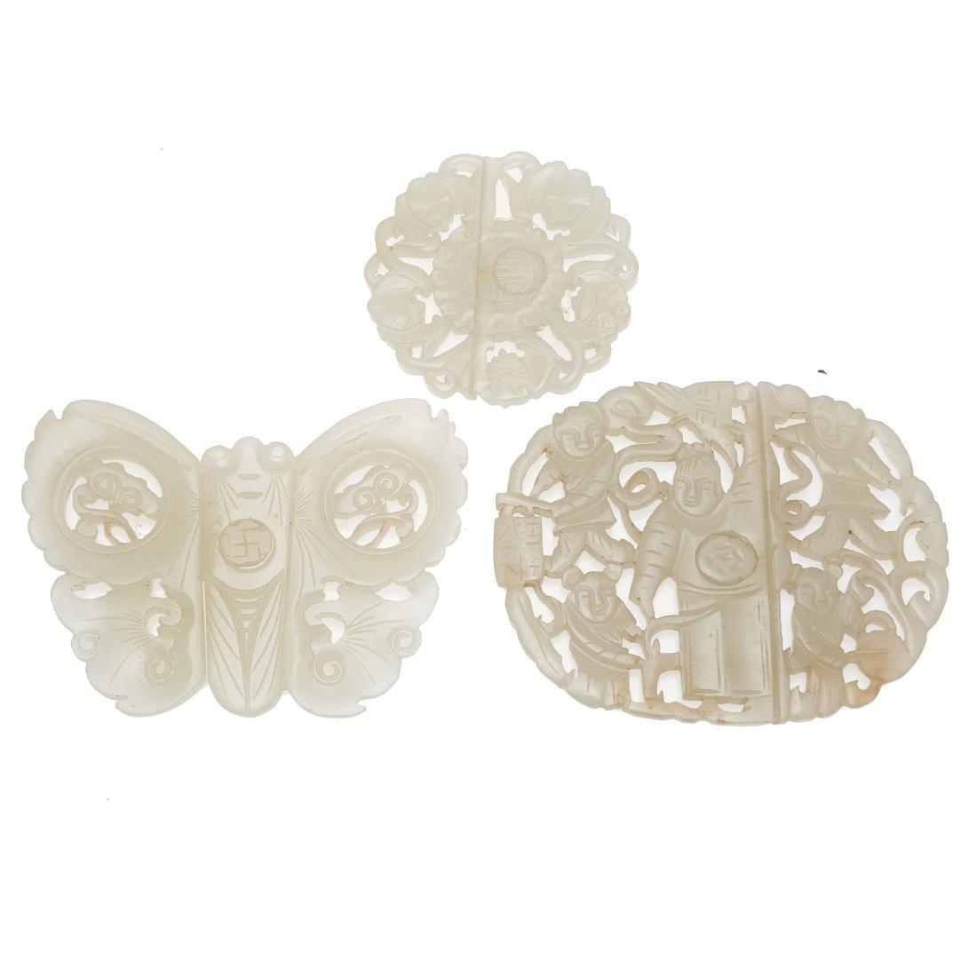 Three Chinese jade openwork belt buckles