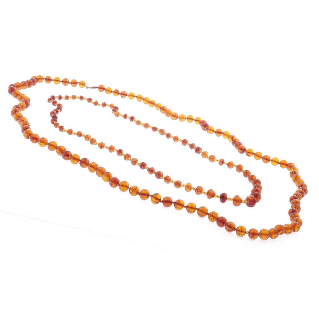 Two Chinese amber necklaces