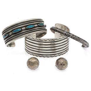 A collection of three silver, turquoise jewelry items