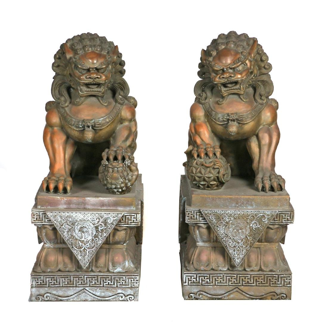 A pair of large bronze Buddhist lions