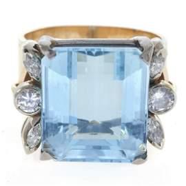 An aquamarine, diamond, 14k ring