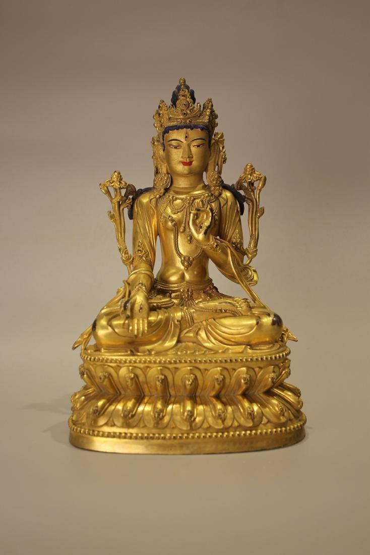 A TIBET GILT BRONZE BUDDHA