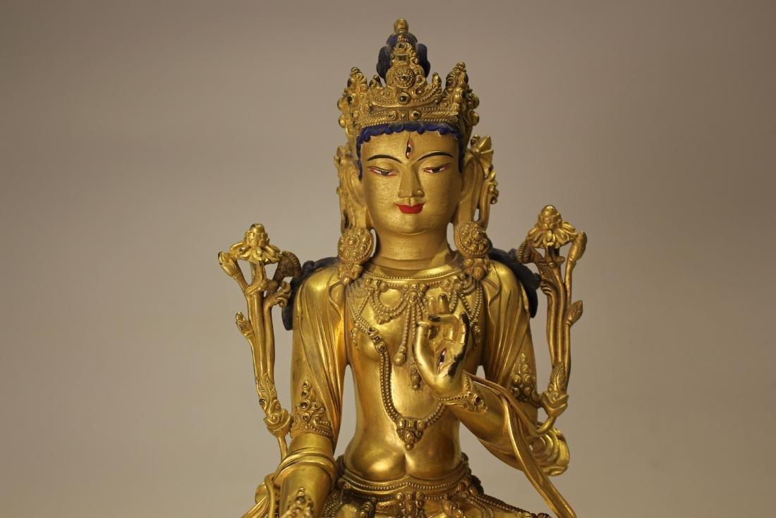 A TIBET GILT BRONZE BUDDHA - 2