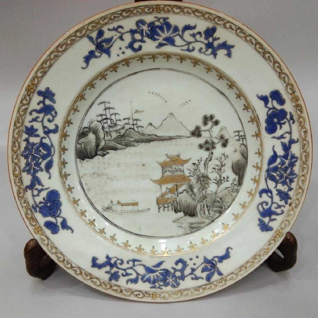 A GILT BLUE AND GRISAILLE PLATE
