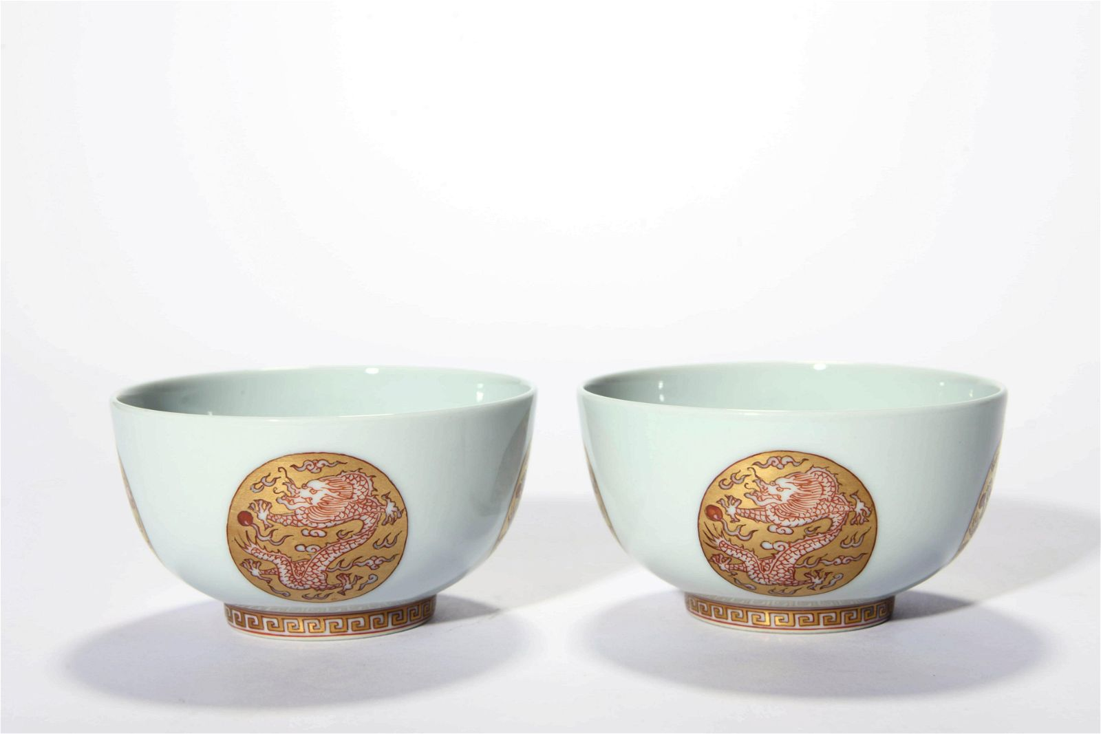 A Pair Of Iron Red Glaze Dragon Bowls