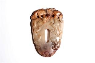 A Brownish Jade Dragon Pendant