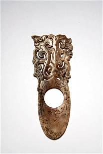 A Carved Brown Jade Dragon And Phoenix Pendant