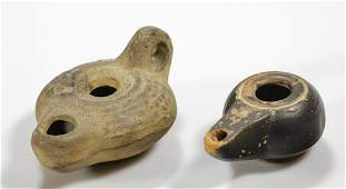 A pair of ancient Greek terracotta oil lamps