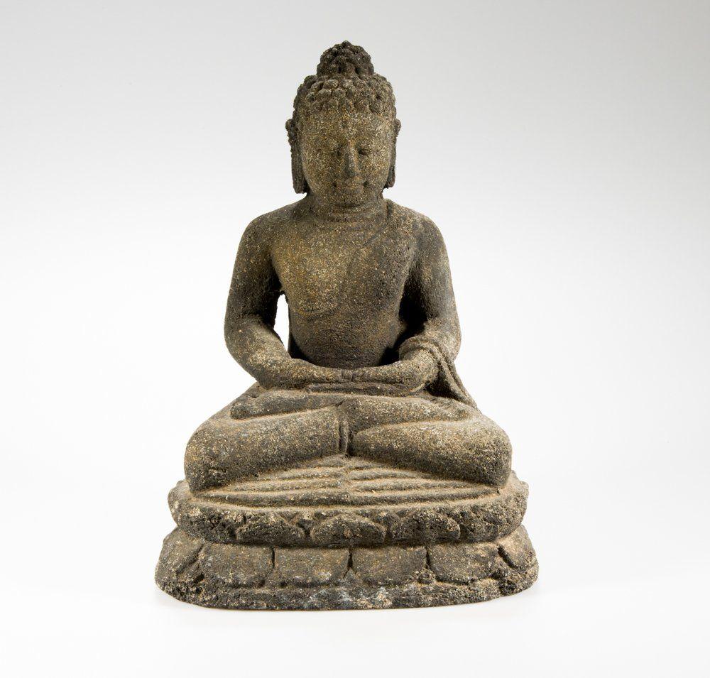 A lava stone carved seated buddha