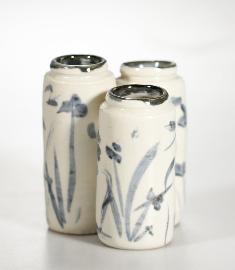 A Korean porcelain triple coupe / vase Yi Dynasty