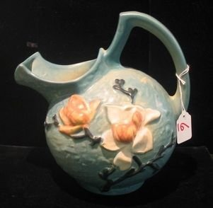 0006: A ROSEVILLE ART POTTERY CIDER PITCHER, in the  Bl