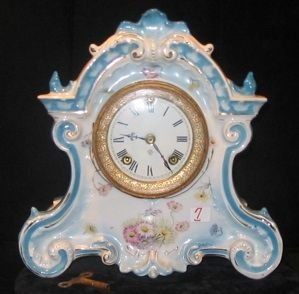 "0007: AN ANSONIA ""CHINA"" PORCELAIN CLOCK, time and  str"
