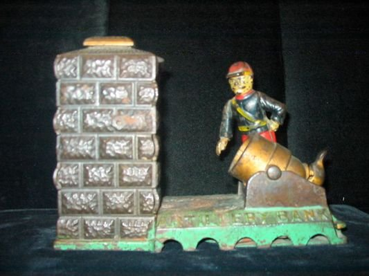 0301: AN AMERICAN CAST IRON AND PAINTED MECHANICAL BANK