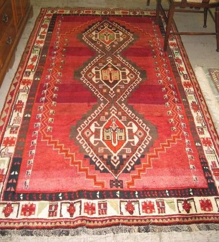 319: PERSIAN SHIRAZ CARPET, the plain red field  center