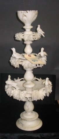 323: AN ALABASTER CARVED TABLE DECORATION, having 3  ti