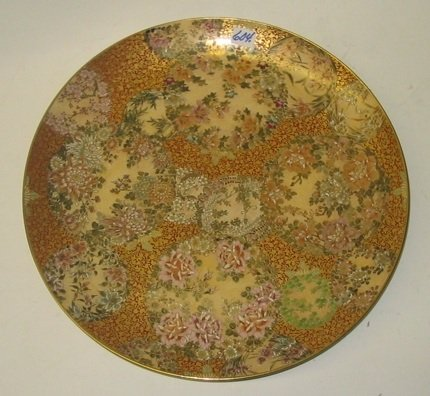 604: A JAPANESE SATSUMA POTTERY CHARGER, hand painted w