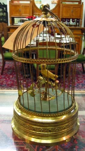 15: A MECHANICAL MUSICAL BIRD IN CAGE.  The yellow  bir